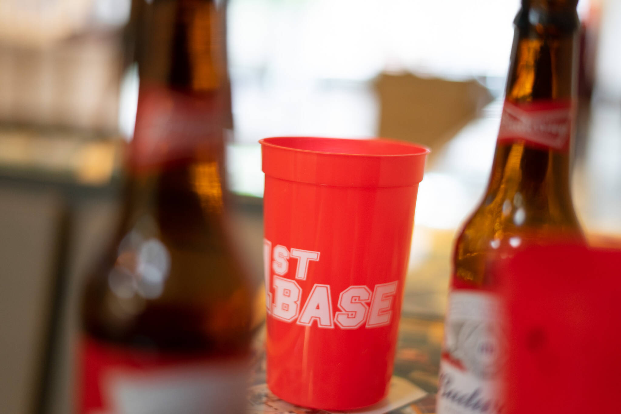 beer bottle and red cup 1st base